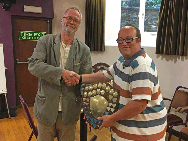 Ben Wilkinson presents the Division 1 trophy to Andrew Kinder representing Newton Abbot.