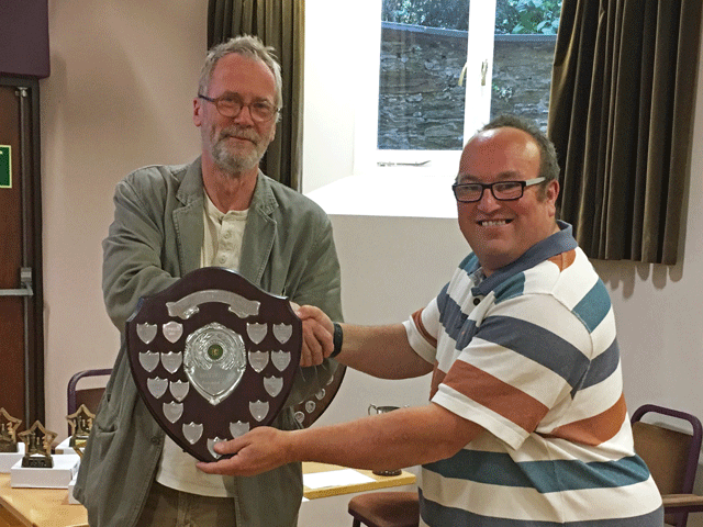 Andrew Kinder presents the Division 3 trophy to Ben Wilkinson the South Hams Division 3 team captain